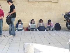 Girls using laptops outside