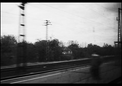 canon loves autumn (beyondthejupiter) Tags: travel red people bw white black art canon dark eos 350d hungary alone sad fear nowhere bored filter trainstation lonely underexposed anywhere