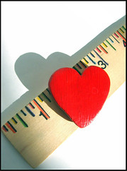 ..measure my love (.emily.) Tags: wood shadow red macro love lines colorful heart bright whitebackground numbers onwhite ruler flickrsoupforthesoul measuring yardstick catchycolorsred