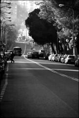 Voy cruzando el ro (JFabra) Tags: madrid street blackandwhite bw espaa blancoynegro canon spain malasaa callesegovia canoneos400d jfabra plazade2demayo
