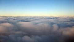 Flying Above the Clouds (wenzday01) Tags: travel wallpaper holland netherlands amsterdam clouds canon flying europe widescreen flight thenetherlands 169 schiphol ams alitalia canonsd450 sd450 amsterdamschiphol