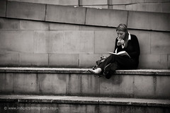 Eve absorbed (paul indigo) Tags: blackandwhite bw apple girl lady reading streetphotography littlestories picswithsoul