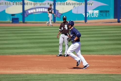 Padres third baseman Kevin Kouzmanoff trots around the bases following his two-run homer off White Sox right-hander Jose Contreras