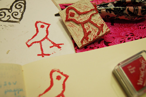 Carved stamp with a bird