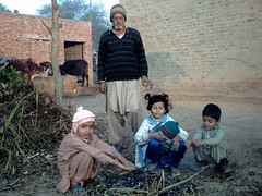 Winter morning, kids are enjoying fire (M.Rizwan Rafique) Tags: old morning pakistan kids rural children fire village child cattle culture