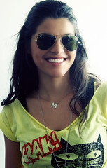 her lovely smile (FatoOoma Qatar ~) Tags: portrait sun sunlight sexy classic girl beautiful beauty smile face smiling shirt female hair happy glasses pretty maria gorgeous teeth adorable lips m greece smiley letter wavy rayban smiler beautifully smiled famel