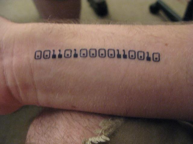 Jons binary tattoo. yay geeky fake tattoos