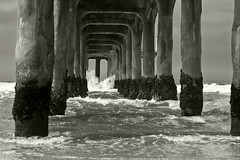 barnacle (richietown) Tags: ocean sea blackandwhite bw topv111 canon la pier losangeles waves pacific crash stock pacificocean getty splash manhattanbeach baywatch 30d 50mm18 richietown