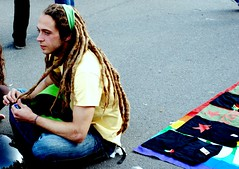 Rasta Philosopher ([Charlotte]ThePhilosopher) Tags: boy guy piercing parade tshirts mayday 2008 castello rasta dreadlock philosopher ragazzo manifestazione cairoli magliette perterra 1maggio2008 unfilosofo