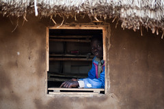 The empty shop   - DR CONGO - (C.Stramba-Badiali) Tags: poverty africa wood boy portrait people house man window face look shop rural pose eyes magasin village mud expression african empty culture 85mm yeux hut human terre conflict blackpeople environment remote tradition ethnic glance humanbeing humanitarian oneperson bois homme visage regard colorphoto africain afrique zaire blackskin lookingatcamera centralafrica ethno fentre gety africanlife ethnie congokinshasa ituri africanboy photocouleur peaunoire congoleseboy lendu canon5dmkii regardcamra forgottenconflict christophestrambabadiali congolesepeople afriquecentraleperson