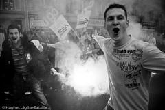 (Hughes Léglise-Bataille) Tags: blackandwhite bw paris france topf25 topf50 noiretblanc protest photojournalism demonstration flare nocrop manif manifestation 2007 cgt retraite pensions retraites fumigene spéciaux régimes
