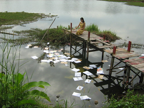 Miss Carol (Carmen Soo) picking books from the pond 2