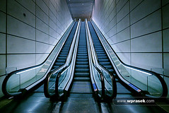 Canary Wharf escalators (wprasek) Tags: uk blue england building london architecture stairs architecturaldetail escalator steps structures a