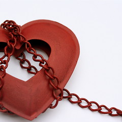 Unchain my heart (cattycamehome) Tags: red white macro love metal tag3 taggedout hearts lyrics bravo tag2 tag1 heart song captured romance minimal chain tied caught locked soe whiteground chained raycharles joecocker catherineingram magicdonkey xoxoxoxox mywinners unchainmyheart november2007 cattycamehome diamondclassphotographer singalongacatty