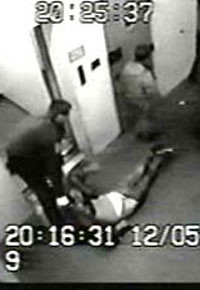 Footage of police dragging Paul.