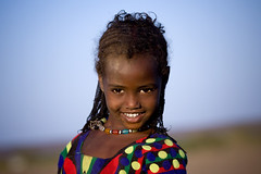 Afar young girl smiling, Danakil, Ethiopia (Eric Lafforgue) Tags: afar africa african africanculture asaita assayta child colorimage confidence culture danakil day eastafrica ethiopia ethiopian ethnic ethnology face females frontview happiness headandshoulders horizontal hornofafrica individuality innocence lookingatcamera mg1819 necklace onegirlonly oneperson pastoralist people photography portrait realpeople smile smiling tradition traditionalclothing traditionalculture traveldestination tribal tribe etipia tribo       thiopien etiopa  ethiopi etiopia  etiopien etiopija  etiyopya    ethiopie