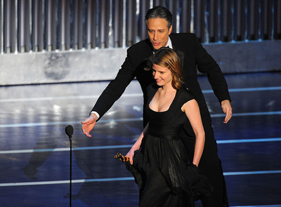 Musician Marketa Irglova and host Jon Stewart onstage during the