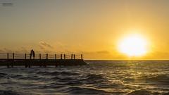 The Kiss Under The Sun. (dasanes77) Tags: sky sun love beach sunrise landscape kiss couple silouette canonef24105mmf4lisusm canoneos6d mygearandme