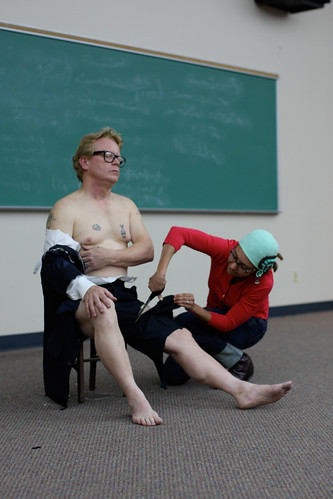 Julia Snead cuts off Ken Littles clothing during his Yoko Ono performance at UTSa downtown.