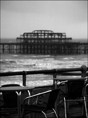 Alfresco (James_Berry Photography) Tags: sea blackandwhite silhouette coast pier seaside brighton waves dof chairs windy tables rough