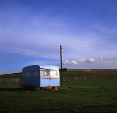 Lonely Caravan (luns_spluctrum) Tags: park uk blue sea england sky cloud 120 6x6 tlr film mobile clouds rollei mediumformat square island bay interestingness interesting static medium format trailer caravan essex rolleicord velvia50 canveyisland canvey thorney rolliecord thorneybay canveyonsea