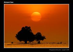 Distant Sun (VJ Spectra) Tags: light sunset sun beach colors landscape thailand nikon telephoto d200 phuket platinumphoto theunforgettablepictures coolestphotographers artinoneshot