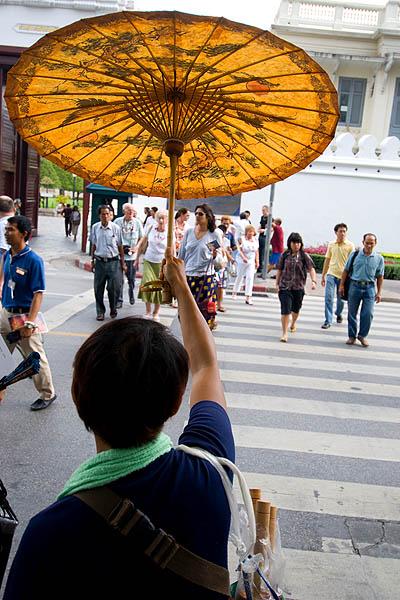 Hawking souvenirs to tourists, Wat Phra Kaew, Bangkok