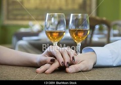 Close-up of young couple hand's on restaurant table with white wine glasses in background (Royal Business Pictures) Tags: pictures man male love boyfriend horizontal closeup loving female restaurant hands girlfriend couple day affection drink flirt anniversary beverage romance celebration indoors alcohol flirting dating romantic dining daytime holdinghands humanrelationships date closeness sideview affectionate celebrating bonding eatingout alcoholicbeverages humanhand heterosexualcouple caucasianappearance alcoholdrink 2529years 2024years