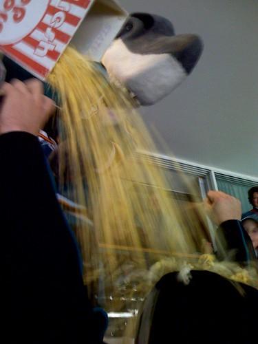 Sharkie - pouring popcorn on Tom