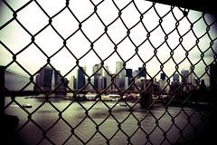 Manhattan (Cormac Phelan) Tags: new york usa america 35mm fence lomo lca xpro lomography dof mahattan hudson provia phelan cormac