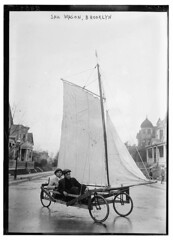 Sail Wagon, Brooklyn  (LOC) (The Library of Congress) Tags: street houses ny newyork men lines brooklyn sailboat river wheels canvas sail vehicle libraryofcongress str sailwagon gaffrig xmlns:dc=httppurlorgdcelements11 dc:identifier=httphdllocgovlocpnpggbain10909