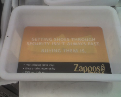 Zappos Ad in Airport Security Tub