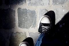 (benbenbenbenben) Tags: brussels canon 350d shoes bruxelles trainers converse feets lookingdown cobbles chucks connies bxl