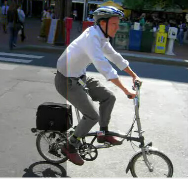 Man on a folding bike