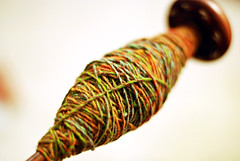 plied yarn on spindle