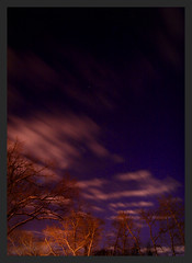 Slipping away (Chris Beauchamp) Tags: longexposure trees sky calgary night clouds stars copyrightchrisbeauchamp20072009