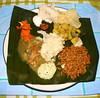 Our feast (Jennifer Kumar) Tags: food india holiday flower america asian culture thai grains poo tamil tamilnadu indianfood pongal pulses southindia lentil dhal bananaleaf harvestfestival asiasouth pongalopongal hinduholidays thaimasam southindianfestival hinducelebraioninus indiainamerica indiancultureinamerica indiaamerica ethnicamericasouth