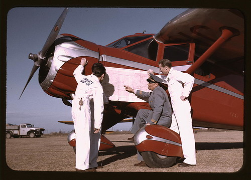 Instructor and students studying a map, Meacham Field, Fort Worth, Tex. (LOC)