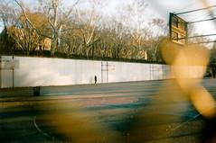 crackhead (skayfr) Tags: park man basketball court walking riverside pentax k1000 homeless lonely crackhead