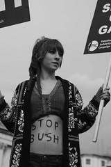 Stop Bush ! (lutonian) Tags: woman blackwhite war flag protest streetphotography trafalgarsquare communism banners stopbush younglady london2008 socialistmarch