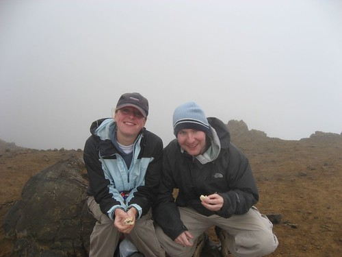 Karen and I grab a bite at the end of a climb up 1,800 vertical feet (crater behind)