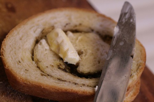 Buttered slice of pesto whirl bread