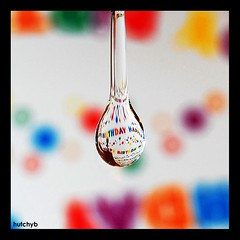 Birthday droplet (hutchyb) Tags: macro water up close bokeh drip refraction happybirthday droplet highspeed wrappingpaper waterdroplet catchycolorsrainbow flickrturns4