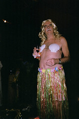 man in grass skirt with wine (ro_hudson) Tags: camera party shells man men eye film real hawaii all dress cross pyramid wine time dream shell photographers vice womens clothes freak single seeing tranny use third mutant void sexylady grassskirt disposable grassy throwaway knowle shellbra