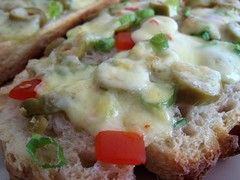 Pepper jack, scallion, and olives on toast
