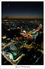 Bangkok (Yazeed) Tags: bridge light sunset moon color building tower cars beautiful night river thailand amazing asia state bangkok 2006 skybar artphoto sirocco blueribbonwinner greatphotographers supershot 5photosaday yazeed abigfave platinumphoto  impressedbeauty aplusphoto kuwaitphoto superbmasterpiece kuwaitartphoto kuwaitart earthasia lebuahotel 63rdfloor nikonflickraward50mostinteresting