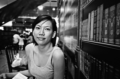 Having Lunch (GenkiGenki) Tags: people blackandwhite bw film girl smile mono singapore jamie 28mm delta gr delta100 suntec ilford foodcourt ricoh sunteccity gr1v foodrepublic