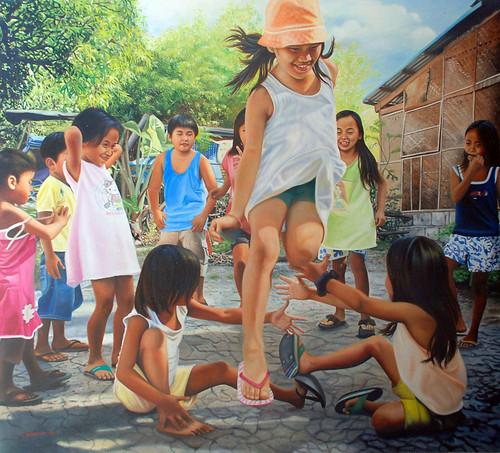 Children playing Luksong Tinik Traditional Street Market game girls