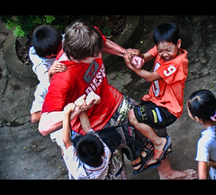 Under Attack! (mliebenberg) Tags: children fun friendship attack vietnam orphans hanoi soe friendshiphouse sheildofexcellence