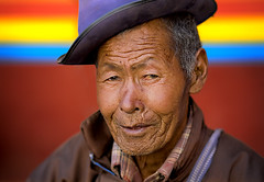 The Man With Blue Hat ( Poras Chaudhary) Tags: blue red portrait india man colors hat bokeh leh ladakh 2007 hemisfestival